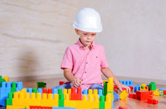 Creative young boy playing with building blocks Royalty Free Stock Photo