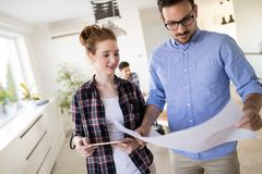 Creative young business people and architects working in office stock image