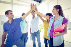 Creative young business people putting their hands together Royalty Free Stock Images