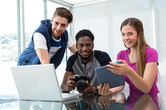 Creative young business team looking at digital tablet Royalty Free Stock Photography
