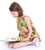 Creative young girl looking photo album. Royalty Free Stock Photos