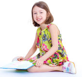 Creative young girl looking photo album. Royalty Free Stock Photography