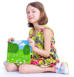 Creative young girl looking photo album. Stock Image