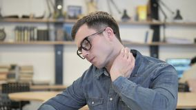 Creative Young Man with Neck Pain Busy Working on Laptop stock video
