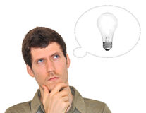 Creative young man thinking of a bright idea Royalty Free Stock Image
