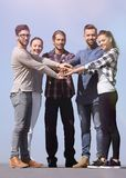 Creative young people is clasped their hands together. royalty free stock image