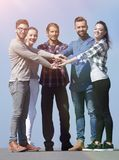 Creative young people is clasped their hands together. Team of creative young people is clasped their hands together.the concept of friendship Royalty Free Stock Image