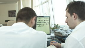 Creative young people develop an idea in the office. HD stock footage