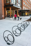 Creatively designed bicycle racks at new building Royalty Free Stock Photos
