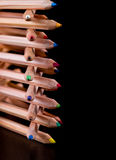 Creatively stacked color pencils Stock Photo