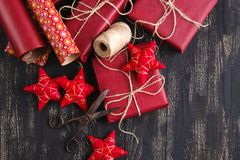 Creatively wrapped and decorated christmas presents in boxes on wooden background. Copy space. Stock Image