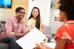 Creatives Having Informal Meeting On Sofas In Design Studio Royalty Free Stock Photo