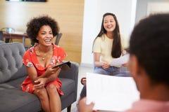 Creatives Having Informal Meeting On Sofas In Design Studio Stock Photos