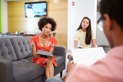 Creatives Having Informal Meeting On Sofas In Design Studio Royalty Free Stock Photography