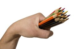 Creativity. A hand full of pencils isolated over white royalty free stock image