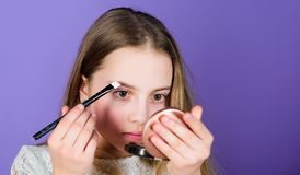 Creativity is best makeup skill. Make up school. Art of makeup. Femininity concept. Salon and beauty treatment. Makeup. Store. Child little girl make up face stock photography