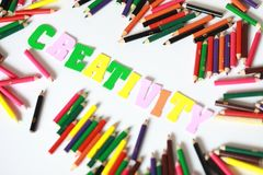 Creativity character ,School supplies colored pencils in Fall scattered, isolated Royalty Free Stock Images