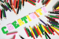 Creativity character ,School supplies colored pencils in Fall scattered, isolated Stock Image