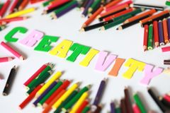 Creativity character ,School supplies colored pencils in Fall scattered,  Royalty Free Stock Photos