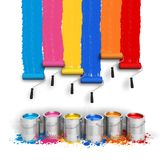 Creativity concept. Set of color roller brushes with trails of paint on the wall and metal cans with oil paint isolated on white background Royalty Free Stock Photography