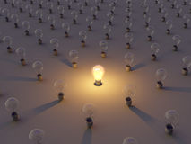 Creativity Concept. One lit bulb in a row of dim ones Royalty Free Stock Photo
