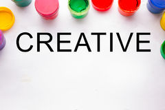 Creativity concept.colorful sign and paint cans. Not isolated royalty free stock photography