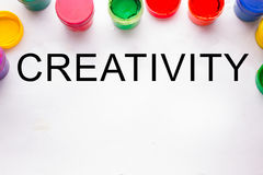 Creativity concept.colorful sign and paint cans. Not isolated stock photo