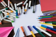 Creativity concept - colour pencil, crayon, watercolour, paint brush, colourful paper and white paper for copy space. Lifestyle and art concept Royalty Free Stock Images