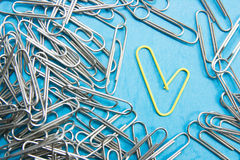 Creativity Concept. Heart shape paper clip.Paper clips of different Stock Photo