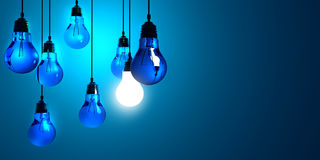 Creativity Concept with Light Bulb. Idea concept, Hanging light bulbs with glowing one isolated on dark blue background Stock Image