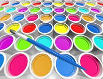 Creativity concept with metal cans with colorful paint dye Royalty Free Stock Photos