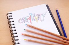 Creativity concept. Writing pad with the word creativity drawn with colored pencils Stock Photography