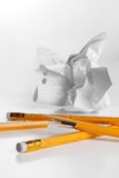Creativity crisis. Chewed pencils and crushed paper Stock Image