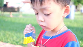 Creativity of cute boy painting plaster figure in the park. stock video footage