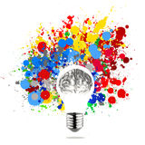 Creativity 3d metal human brain. In visible light bulb with splash colors background as concept Stock Photo