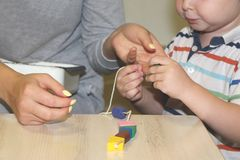 The educator deals with the child in the kindergarten. Creativity and development of the child royalty free stock photos