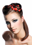 Creativity hairstyle and fashion make-up. Portrait of a cute young woman with creativity hairstyle and fashion make-up Stock Image