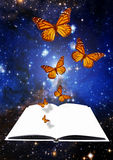 Creativity and imagination. Butterflies flying over a white blank open book against a space background, creativity and imagination concept Royalty Free Stock Photo