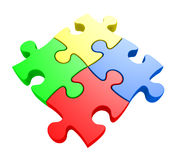 Creativity and problem solving concept of four jiwsaw puzzle pieces connected together. Four parts of a puzzle in yellow, blue, red and green locked together Royalty Free Stock Photography