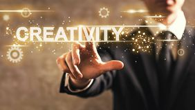 Creativity text with businessman Stock Images