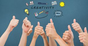 Creativity text with icons over hands gesturing thumbs up. Digital composite of Creativity text with icons over hands gesturing thumbs up Royalty Free Stock Photography
