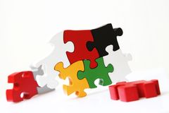 Creativity with wooden puzzle. With white background Stock Images