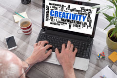 Creativity word cloud concept on a laptop screen. Creativity word cloud concept shown on a laptop used by a man royalty free stock photo