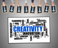 Creativity word cloud concept on a whiteboard. Hands holding writing slates with arrows pointing on creativity word cloud concept stock images