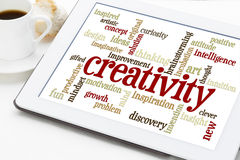 Creativity word cloud on digital tablet Stock Image