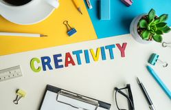 Creativity word on desk office background with supplies. Stock Photo