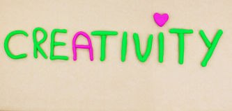Creativity written in modelling clay Stock Photography