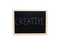 CREATIVO scritto con gesso bianco sulla lavagna Fotografia Stock Libera da Diritti