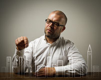 Creator. Man in thoughts. Man in white creating city plan Stock Photography