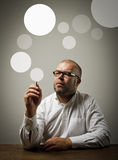 Creator. Man in white and gray bubbles. Stock Images